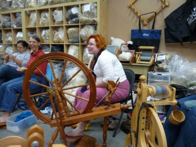 Our hostess, telling stories and spinning thread-fine yarn.