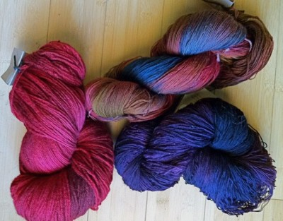 One skein of Glory Days and two skeins of Peaceful.