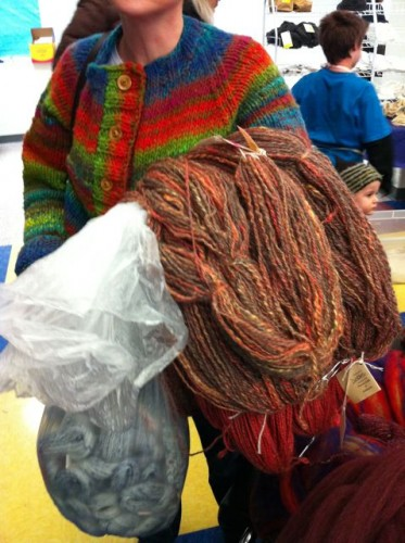 An armful of handspun yarn