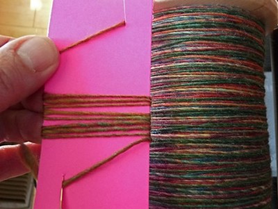 Checking singles. The fiber is Blue Moon BFL Rocktober colorway.