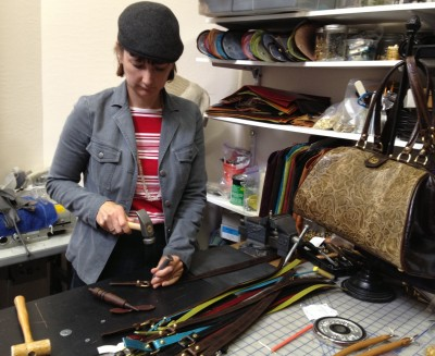 Larisa making leather handles