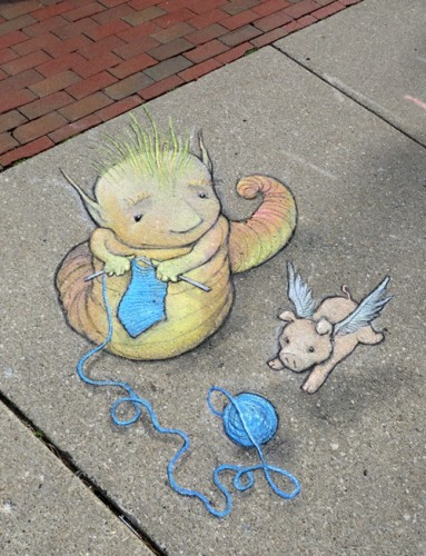 Knitting on the sidewalk with a flying pig as one does...