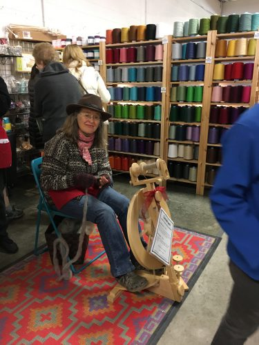 a happy spinner trying out a Lendrum wheel