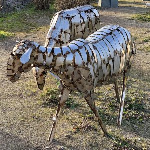 Metal sculpture of two sheep