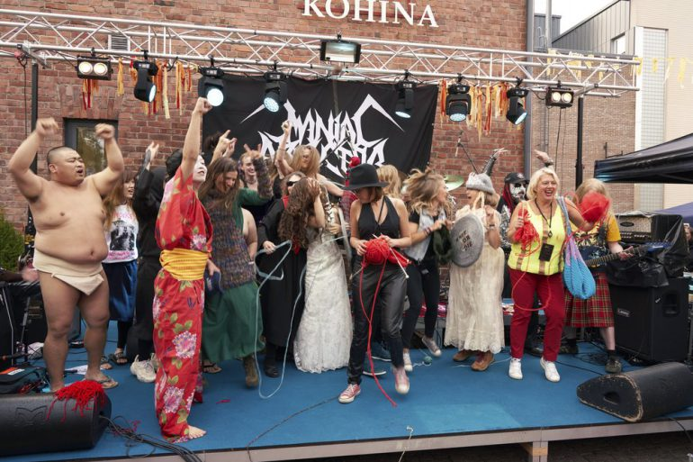 photo of participants of the heavy metal knitting champtionship on stage