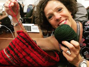 sue montgomery & her knitting record of men vs women speaking at council meeting.